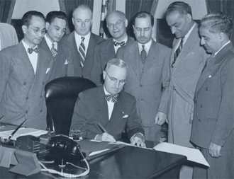 PRESIDENT TRUMAN SIGNING THE LUCE-CELLAR ACT 1946
