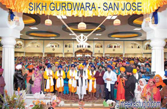 Sikhs praying at the opening ceremony of Gurdwara in San Jose