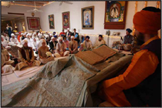 Sikh reading from Guru Granth Sahib Ji