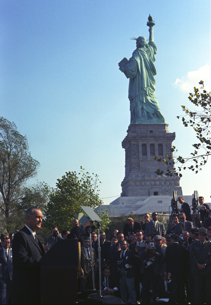 President Lyndon Johnson visits the Statue of Liberty to sign the Immigration and Nationality Act of 1965